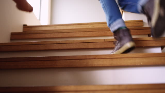 Race you to the top! 4k video footage of two little children running up a staircase at home staircases stock videos & royalty-free footage