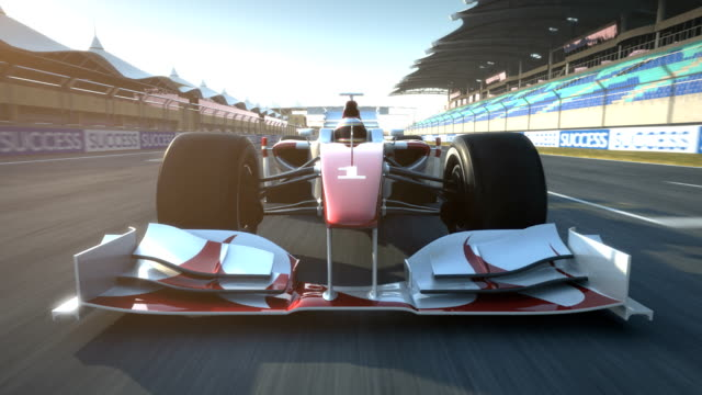 racecar speeding past camera - front view