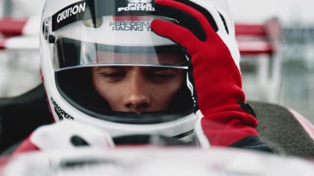 Racedriver closes his visor