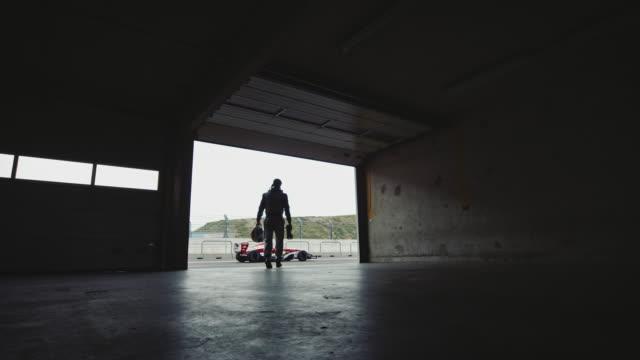 Racedriver walks to his car