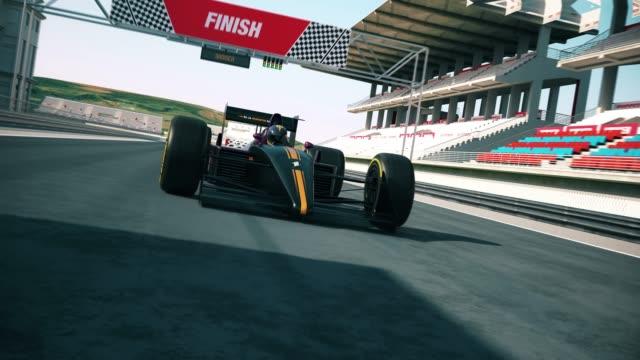 vídeos de stock e filmes b-roll de racing car crossing finish line and winning the race. different sunlight - campeão desportivo