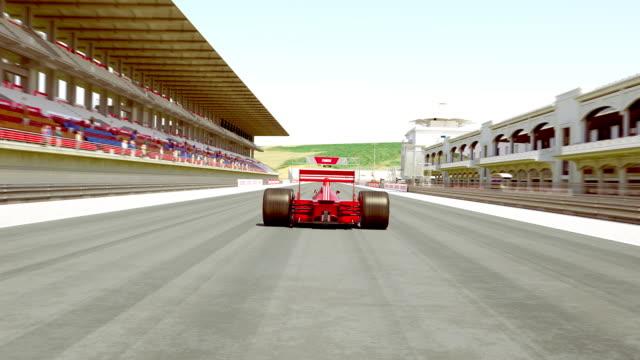 레이싱 자동차 횡단 결승 선 다음 제동 - formula 1 스톡 비디오 및 b-롤 화면