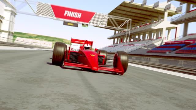 레이스를 이기는 차를 교차 하는 결승 선을 경주 하십시오 - formula 1 스톡 비디오 및 b-롤 화면