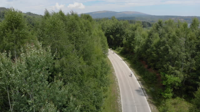 racing cyclists on road - ciclismo su strada video stock e b–roll