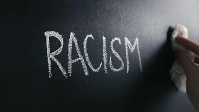 rasism koncept. sluta med hat och diskriminering. mot fördomar och våld. - etnicitet bildbanksvideor och videomaterial från bakom kulisserna