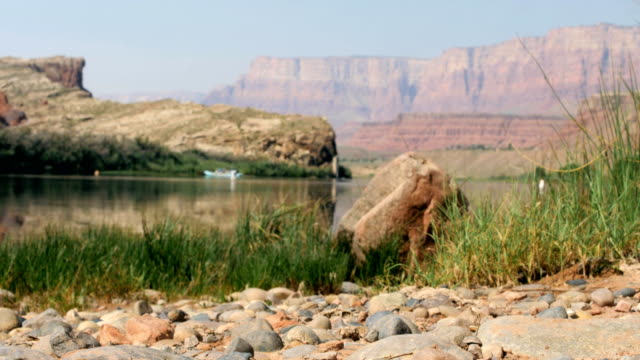 rack focus desert to rafters on Colorado river in the Grand Canyon video