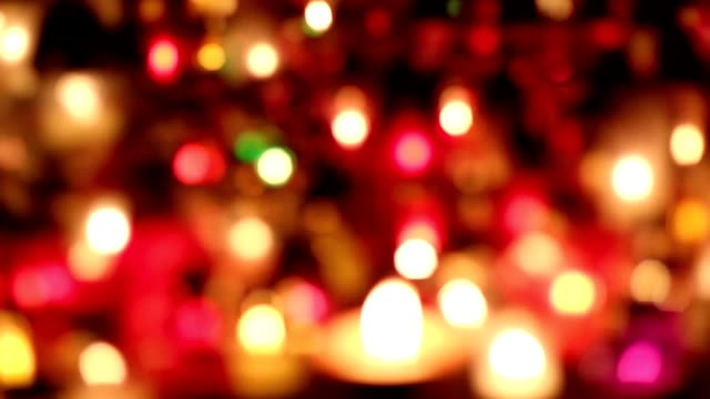 Rack focus grave candles at night video