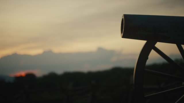 Rack Focus Shot of a Silhouette of a US Civil War Cannon from Gettysburg National Military Park, Pennsylvania at Sunset
