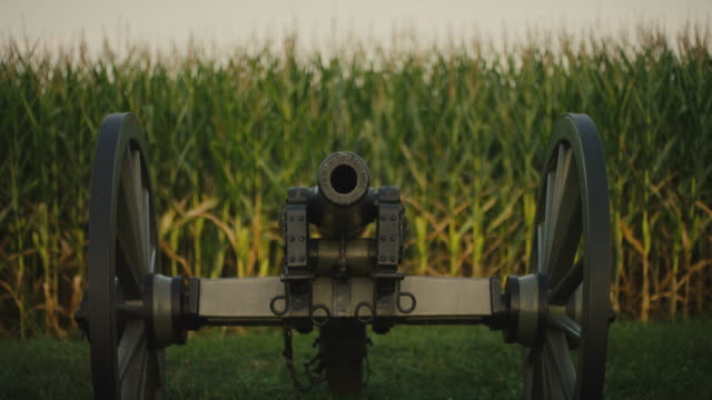 Rack Focus Shot of a US Civil War Cannon from Gettysburg National Military Park, Pennsylvania Next to a Corn Field