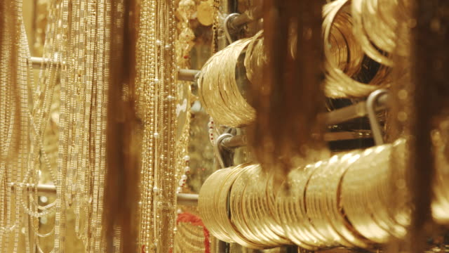 Rack focus shot of jewellery for sale at store, Dubai, United Arab Emirates video