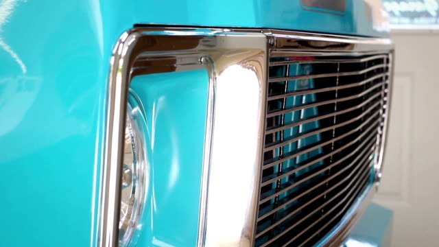 Rack focus to steel front grill of refinished vintage retro truck