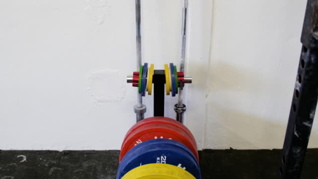 rack of barbell weight. - weights stock videos & royalty-free footage