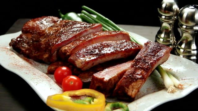 Rack of ribs on platter with amenities. Left Rotation. video