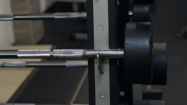 rack with mini barbells, sports equipment in gym