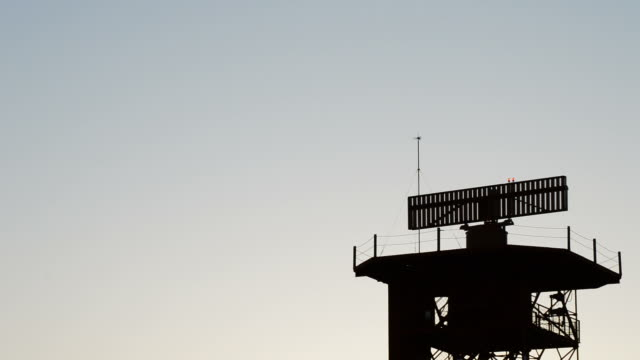 Radar gyrating in tower of telecommunications in airport at sunset video