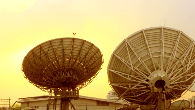 Radio telescope in evening at sunset, time lapse video