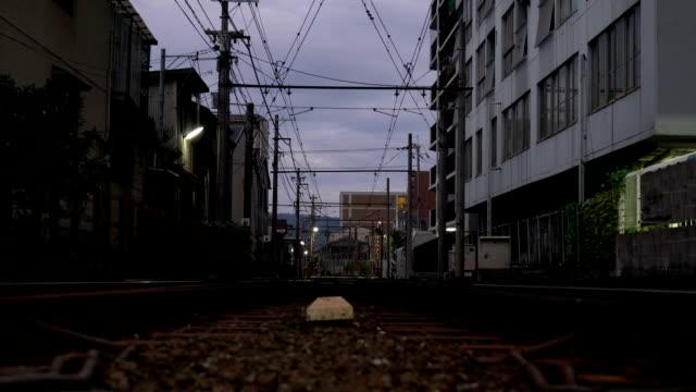 a railroad crossing of randen or keifuku electric railroad early in the morning in kyoto - cisza filmów i materiałów b-roll
