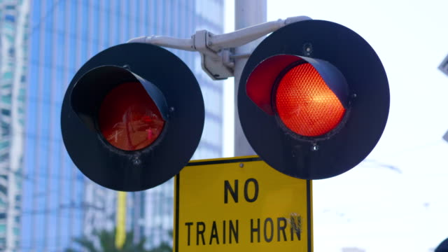 Railroad Crossing Train Sign and flashing lights in 4K Slow motion 60fps video