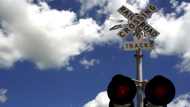 Railroad Track Crossing RR Warning Lights Clouds Roll Blue Sky video