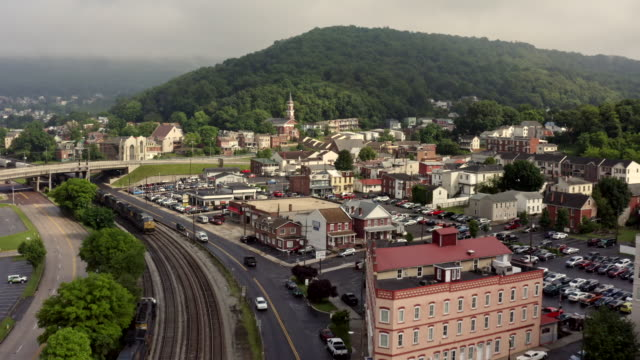 Railroad tracks to Rail Station in small town Cumberland Maryland Rail line and train tracks through small town Cumberland, Maryland and Appalachian Mountains. americana stock videos & royalty-free footage