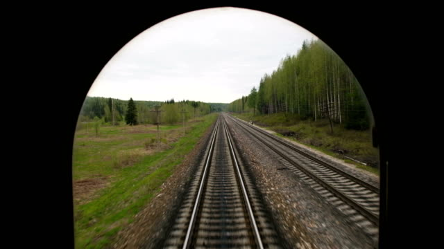 Railroad tracks while the train travels fast. video
