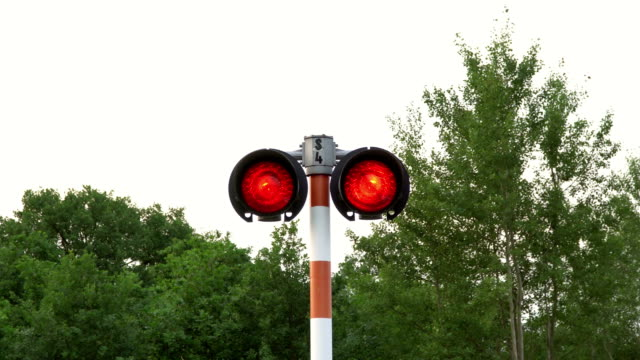 Railway crossing signal pulsating in red. Slow zooming. video