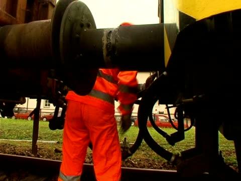 railway employee Railroad employee working on a train railing stock videos & royalty-free footage