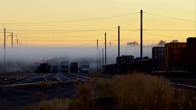 vídeos de stock e filmes b-roll de railway in fog. rails stretching out into the fog. with rails. the railway. morning fog waiting for road trains - cabo verde