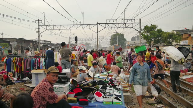 Railway Market in near Duri Station Jakarta In the morning the residents of dense settlements around the Duri station in Jakarta using rail as a market area. jakarta stock videos & royalty-free footage