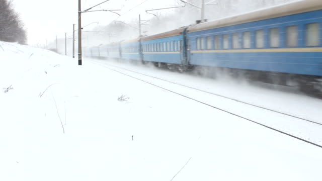 Railway track with train in winter. video