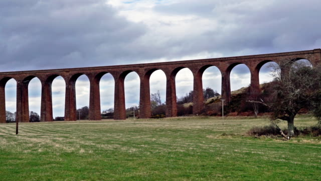 Railway viaduct, Nairn, Scottish Highlands, UK, panning right to left