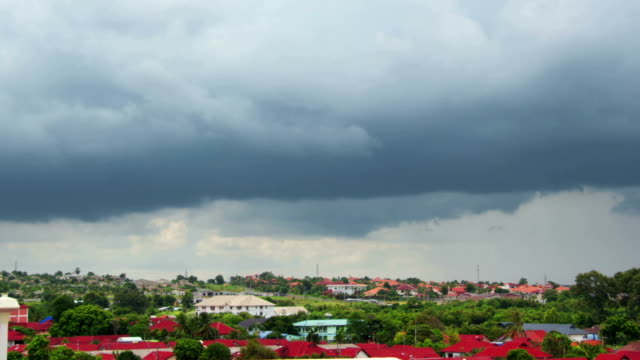 rain clouds over tropical village timelapse video