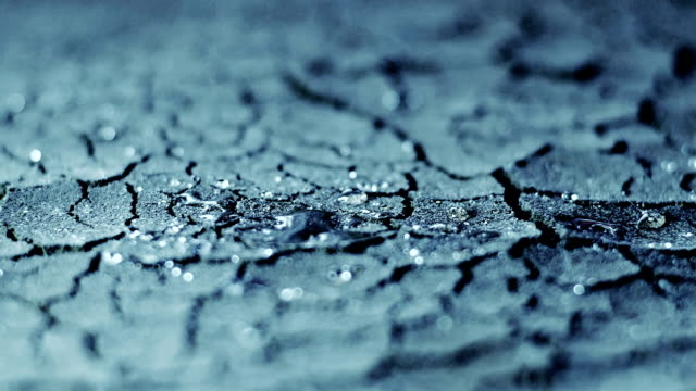 Rain Drops on dry soil slow motion video