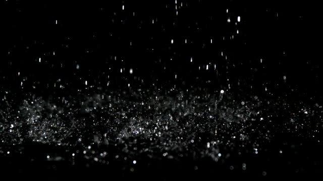 Rain falling on black surface video