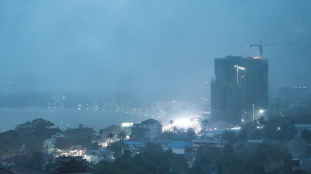 rain falling on yangon city, time lapse video - burma home do стоковые видео и кадры b-roll
