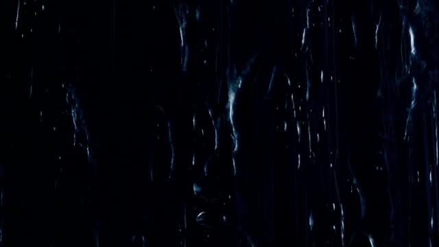 Rain Hits Surface On Black Closeup video