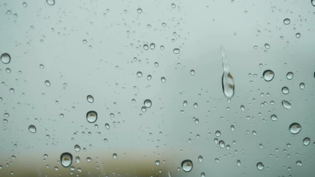 Rain On Glass Of Window With Outside. Close Up. Slow Motion. Rain On Glass. Rain Drops Water On Car Window Background. Bad Weather Autumn.