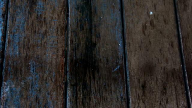 rain on wood floor video