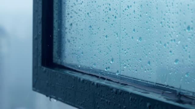 rain pooling from window condensation - davanzale video stock e b–roll
