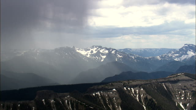 Rain Storm Over the Absaroka Range  - Aerial View - Wyoming,  Park County,  helicopter filming,  aerial video,  cineflex,  establishing shot,  United States video