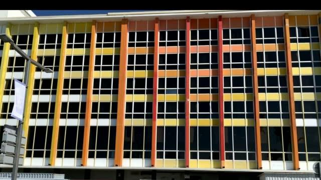 Rainbow building on the Gordon promenade. Dan Hotel, designed by Israeli artist Yaacov Agam. HD Tel Aviv, Israel - March 09, 2019 : Rainbow building on the Gordon promenade. Dan Hotel, designed by Israeli artist Yaacov Agam.HD ocean front properties stock videos & royalty-free footage