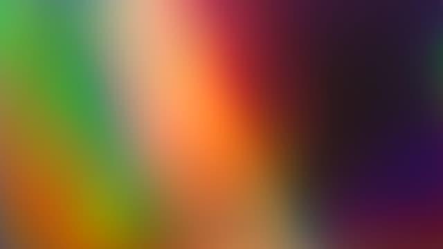 虹のグラデーション。ダイナミックモーション。カラフルな抽象的な背景。発光超現実的なぼやけ動くグラデーション - 玉虫色点の映像素材/bロール