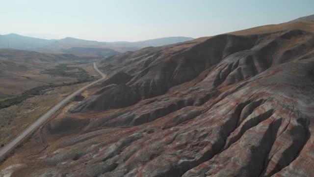 Rainbow hills of Khizi, landscape red mountains. Xizi, Azerbaijan. Aerial video 4k