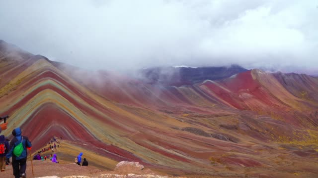 Rainbow Mountains at 5200 meters in Peru View on one of nature wonders, the Rainbow mountains in Peru with people visitng at 5200 meters rainbow stock videos & royalty-free footage