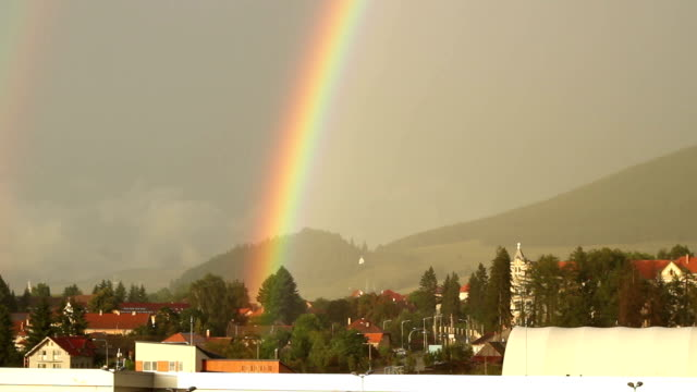 Rainbow over City Beautiful rainbow rising over the citu after a summer rain. florida us state stock videos & royalty-free footage