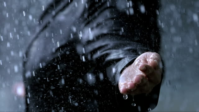 Raindrops Falling On A Hand (Super Slow Motion) video