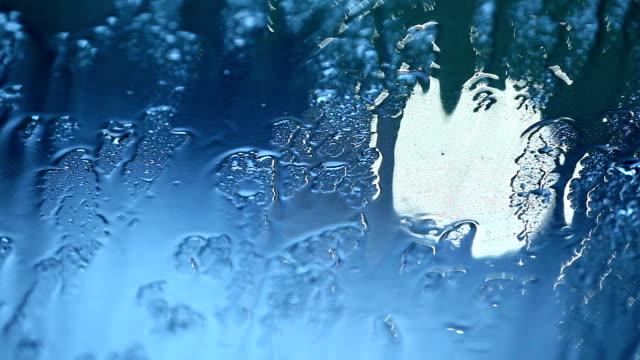 Raindrops splashing video