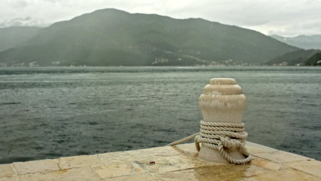 Rainfall at pier on the sea
