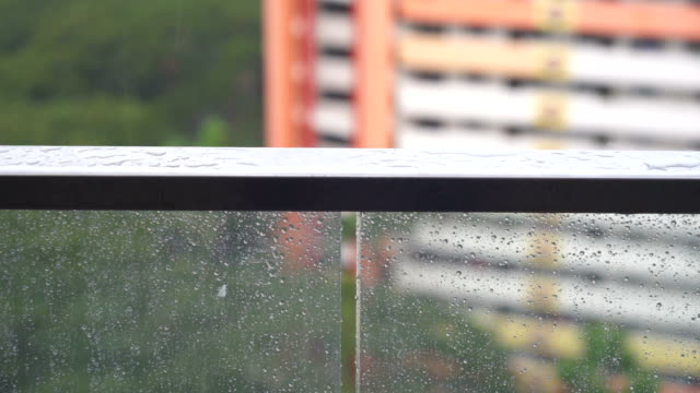 Raining Drop on stainless steel balcony rail in the rainy day, Rain droplets at the terrace video