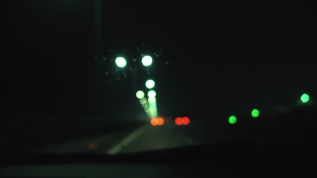 rainstorm in highway - rack focus video stock e b–roll
